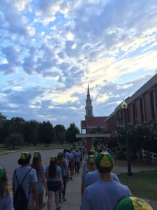 Students marched under the looming figure of Raley Chapel.
