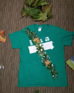 Green shirt with diagonal band of leaves