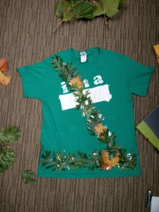 Green shirt with diagonal band and belt