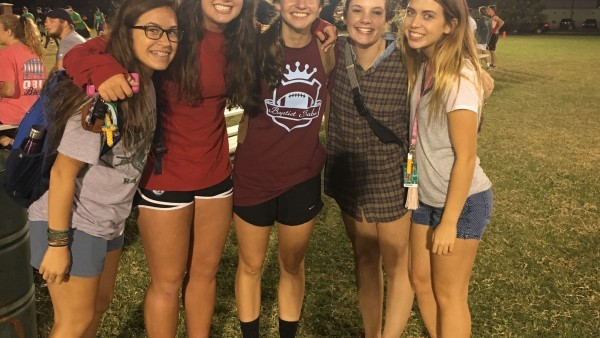 My friends and I supporting friend in middle, Jasmine, at her intramural flag football game