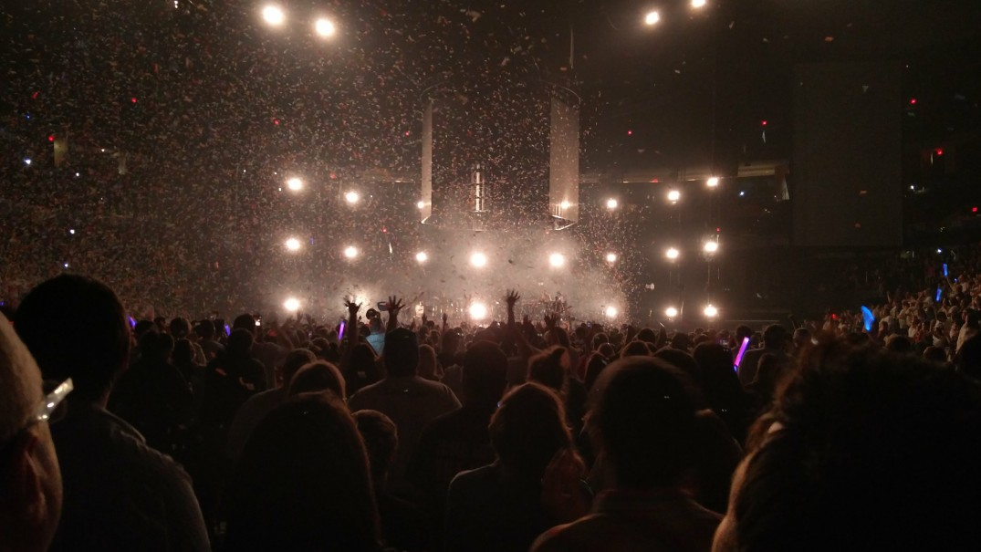 Crowd facing forward with confetti in the air