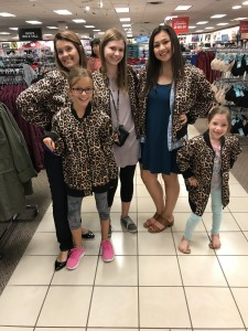 Shopping comes with dad taking a picture of all the girls in matching cheetah-print jackets